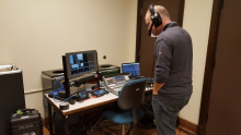 Local producer Ed Liming at the mobile production center outside Gowen 301