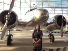 Anne Melton standing in front of propeller airplane