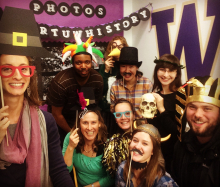 History Fellows with photo booth props