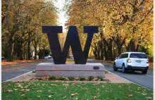 W at the entrance of campus