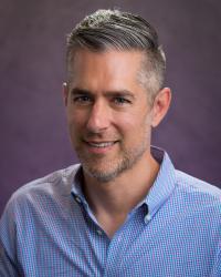 Professor Adam Warren