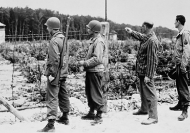Image of a concentration camp with soldiers