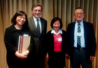 Faculty and graduate students accepting awards and fellowships