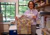 Devin Naar holding Ladino artifact