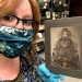 Amanda Robb, working at Hoover Institutions, with a potrait of Empress Dowager Cixi